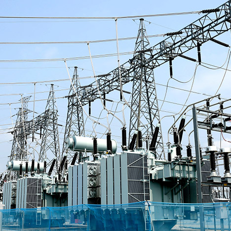 an electrical substation with transmission lines