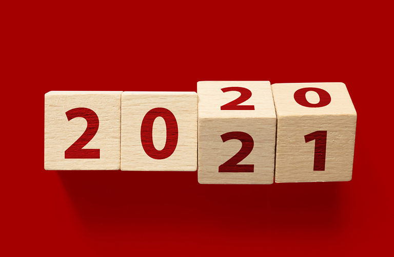 Wood blocks with 2020 turning to 2021