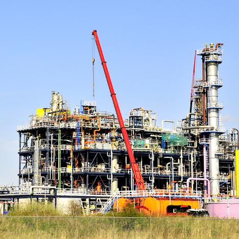 construction crane building a chemical plant
